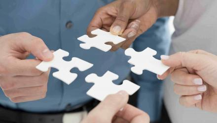 Closeup Businesspeople Hand Holding Jigsaw Puzzle