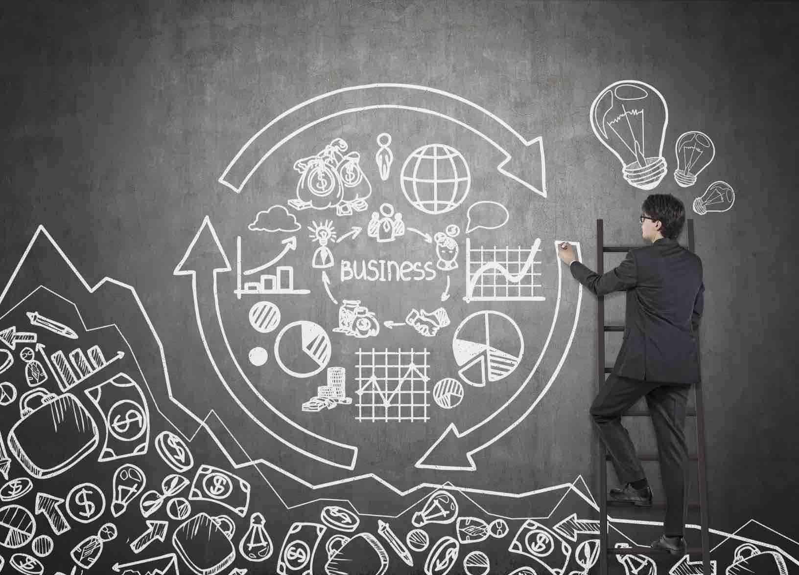 man drawing business chart