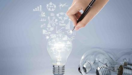 Light bulb with hand drawing graph